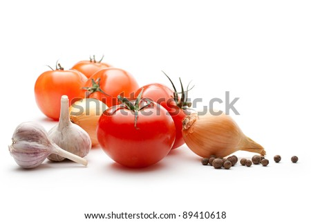Tomatoes, onions, pepper and garlic isolated on the white background - stock photo