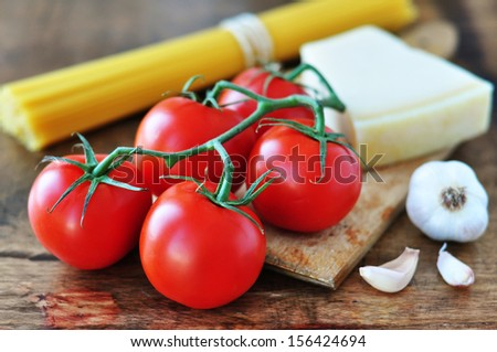 Tomatoes, Parmesan and spaghetti - stock photo