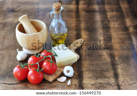 Tomatoes, Parmesan, garlic and olive oil - stock photo