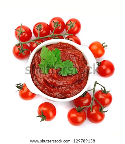 Tomatoes paste with greens on white - stock photo
