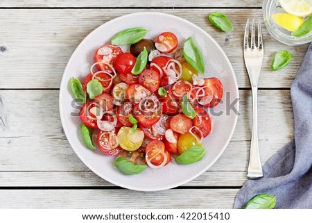 Tomatoes salad with basil and shallot. Concept of healthy eating.Selective focus - stock photo