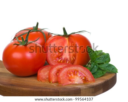 Tomatoes vertical presentation sliced on wooden plank 2 isolated on white background