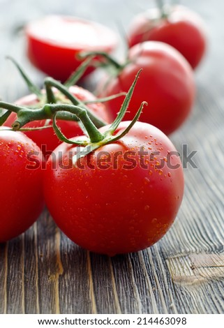 Tomatoes with drops of water on a table
