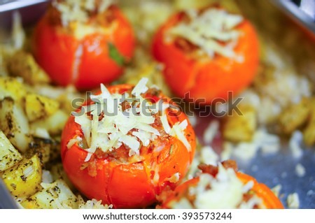 Tomatoes with meat and cheese filling in a oven dish - stock photo