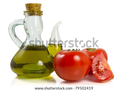 Tomatoes with olive oil - stock photo