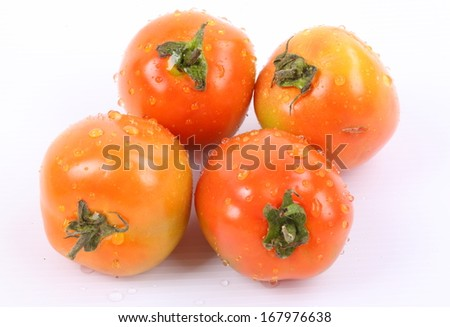 Tomatoes with water drops isolated on white background