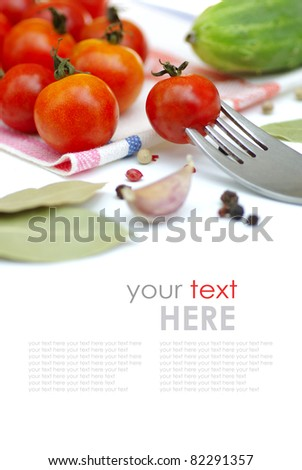 Tomatos and cucumbers on white background (with sample text).Fresh ingredients - stock photo