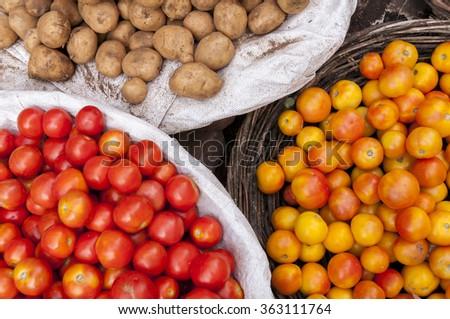 Tomatos and potatos at the indian market - stock photo