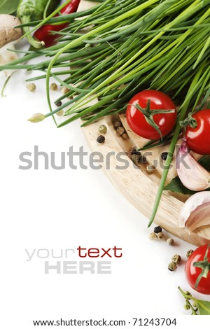 Tomatos, chives, peppers and garlic on white background. With sample text