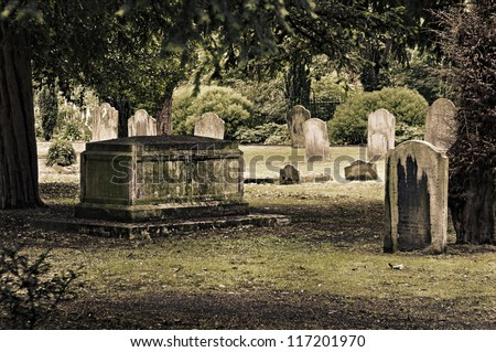Tombs in an English cemetery - stock photo