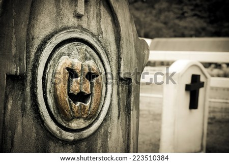 Tombstone and grave in graveyard, Halloween  - stock photo
