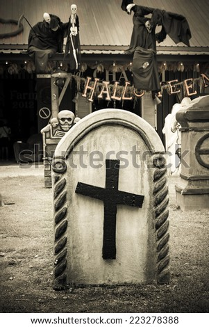 Tombstone and graves in graveyard, halloween - stock photo