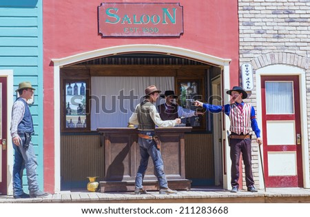 TOMBSTONE , ARIZONA - AUG 09 : Actors takes part in the Re-enactment of the OK Corral gunfight in Tombstone , Arizona on August 09 2014.  - stock photo