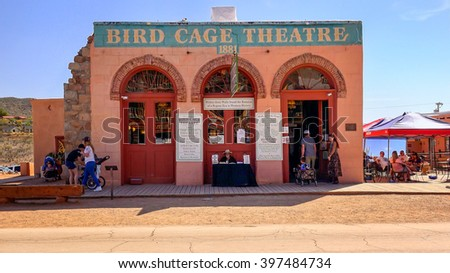 TOMBSTONE, ARIZONA - MARCH 20: A stagecoach loaded with tourists passes the historic Bird Cage Theatre in Tombstone, Arizona on March 20th, 2016. - stock photo