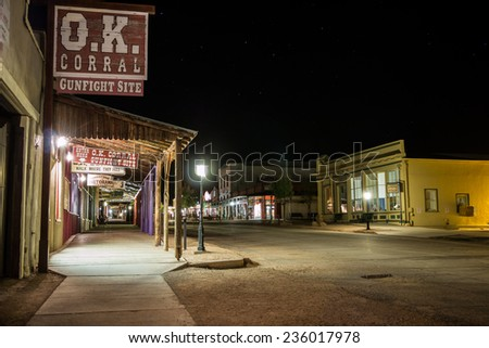 TOMBSTONE, ARIZONA - NOV 15, 2014: O.K. Corral and Allen Street in Tombstone, Arizona. Shot at night with long exposure. - stock photo