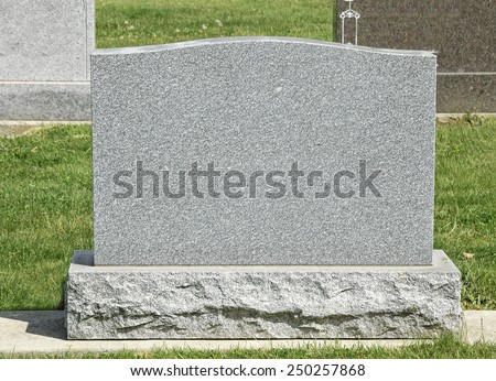 Tombstone in a cemetery - stock photo