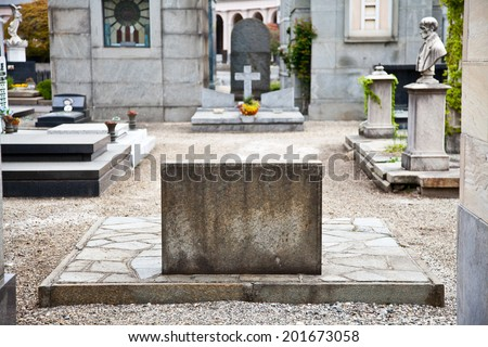 Tombstone in Italian cemetery with copy space - stock photo