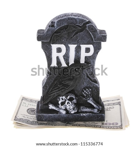 Tombstone with money isolated on white background - stock photo