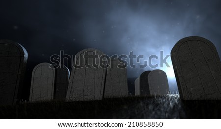 Tombstones in a graveyard at night lit by an ethereal eerie light - stock photo