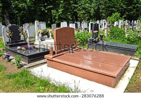 Tombstones in the cemetery - stock photo