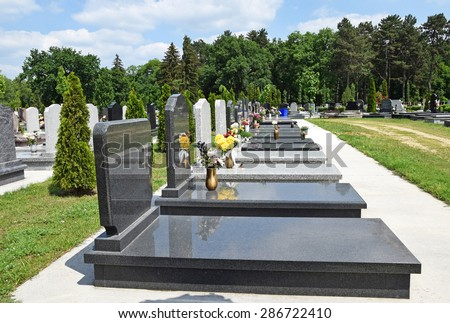 Tombstones in the public cemetery - stock photo