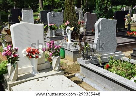 Tombstones in the public cemetery - stock photo