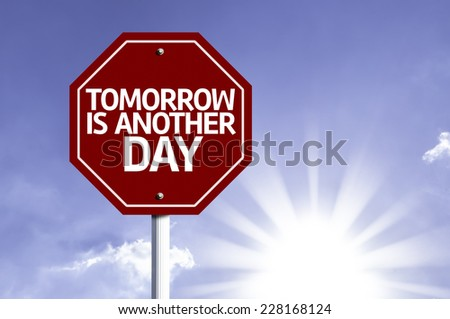 Tomorrow is Another Day written on red road sign with a sky on background - stock photo