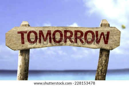 Tomorrow sign with a beach on background - stock photo