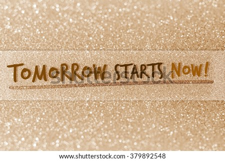 Tomorrow starts now on glitter abstract background - stock photo