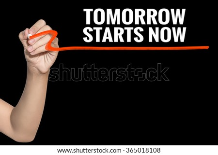 Tomorrow Starts Now word write on black background by woman hand holding highlighter pen - stock photo