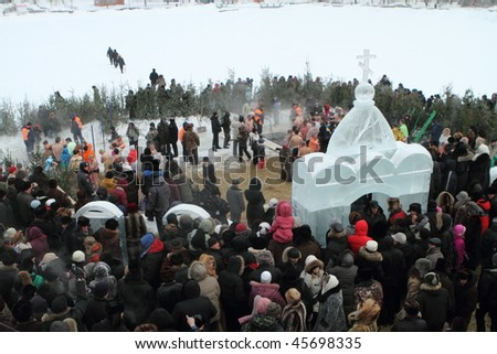 TOMSK, RUSSIA - JANUARY 19: Swimming in the ice-hole, celebration of Epiphany (Holy Baptism) in the Orthodox tradition, January 19, 2010 in Tomsk, Russia.