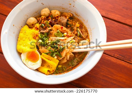 Tomyum noodle with chopstick and spoon