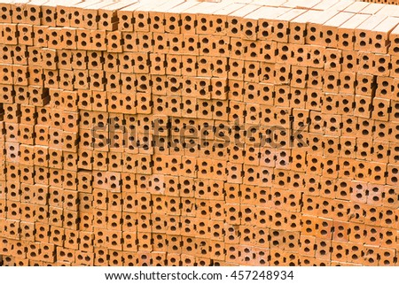 Ton of brown bricks for making building /structure in natural pattern.