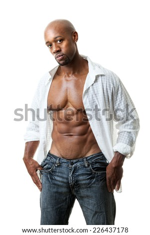 Toned and ripped lean muscle fitness man wearing an open shirt and jeans isolated over a white background. - stock photo