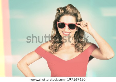 Toned and stylised retro photo of a beautiful woman fashion model wearing summer red sunglasses. Vintage pinup poster girls - stock photo