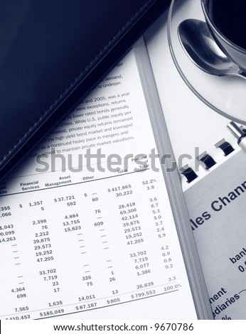 Toned business still life with coffee and financial reports - stock photo