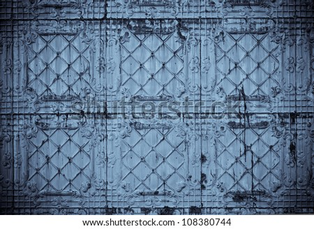 Toned close up of authentic tin tiles on an exterior wall great for scrap booking - stock photo