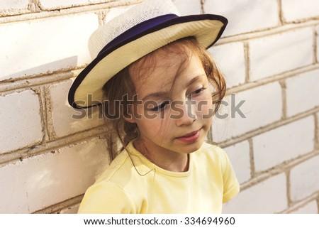 Toned Closeup portrait of sad cute little girl dreaming. - stock photo