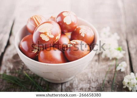 Toned Image. Easter Eggs Decorated with Natural Fresh Leaves and Boiled in Onions Peels - stock photo