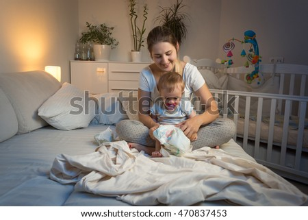 Woman Changing Diaper Stock Images Royalty Free Images