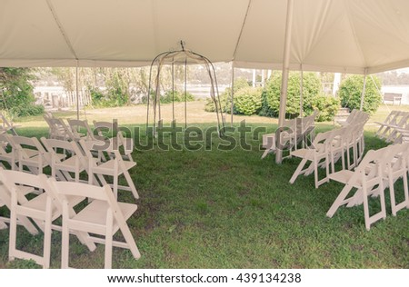Toned image of outdoor tent set up for wedding.