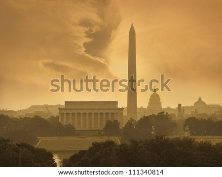 Toned image of the Washington DC skyline with menacing clouds - stock photo
