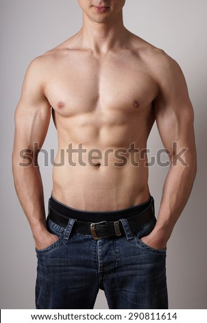 toned male torso with muscular arms and sixpack fitness or bodybuilding concept - stock photo