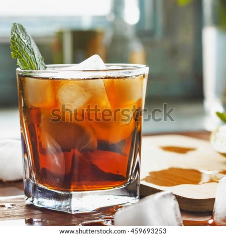 Toned photo. closeup rum in a glass with ice, view from above