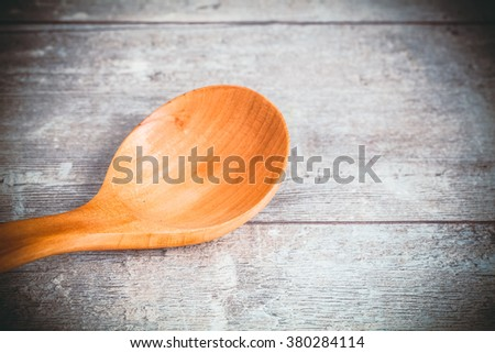 Toned photo. Color tone tuned. Wooden table and spoon - stock photo