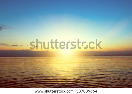 Toned Photo of Beautiful Summer Landscape of the Calm Sea and Sunset - stock photo