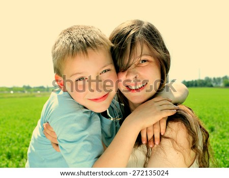 Toned Photo of brother and sister in the summer field - stock photo