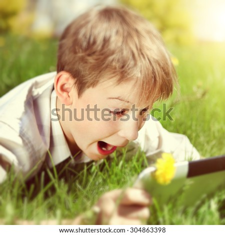 Toned Photo of Cheerful Kid with Tablet Computer - stock photo