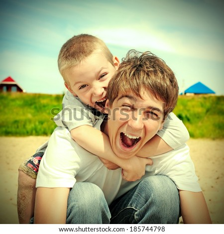 Toned photo of Happy Brothers outdoor - stock photo