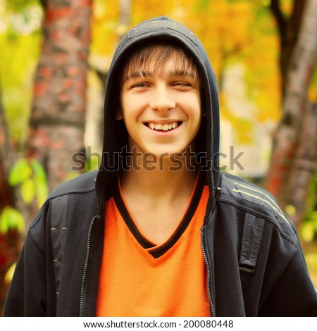 Toned photo of Happy Teenager at the Autumn Park - stock photo